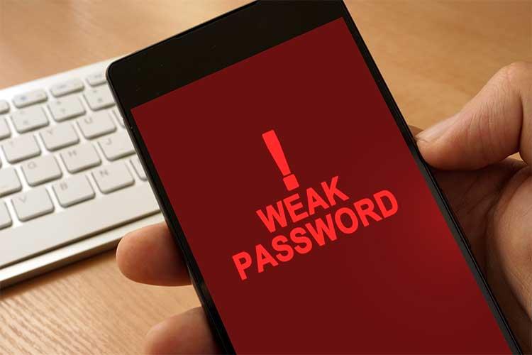 Phone with weak password warning on screen