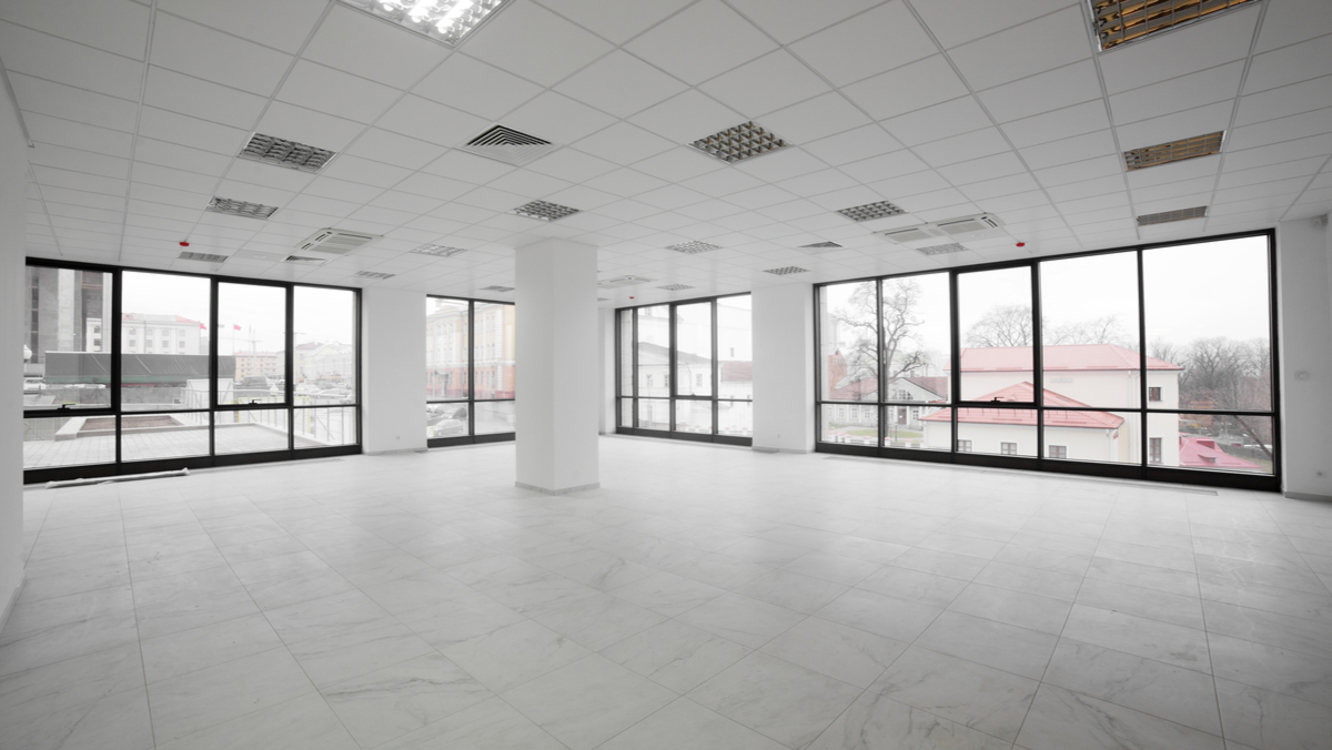 Traditional office space with blank walls and no furniture